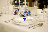 Elegant blue and white Christmas table setting — Stock Photo