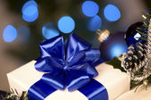 White gift with blue ribbons — Stock Photo
