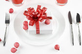 Gift on plate as table decorations — Stock Photo