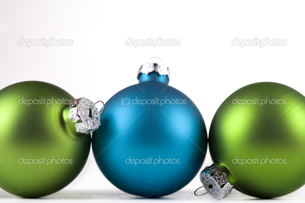 Blue and green Christmas ornaments lined up, isolated — Stock Photo #14948313