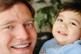 Father and infant son smiling together — Stock Photo