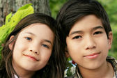 Brother and sister smiling outdoors — Stock Photo