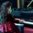 Child playing piano — Stock Photo