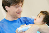 Father holding sick baby in hospital — Stock Photo