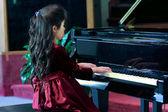 Child playing piano — Stock Photo