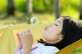 Child blowing dandelion — Stock Photo