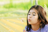 Child blowing dandelion — Stock Photo
