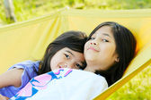 Two girls on a hammock — Stock Photo
