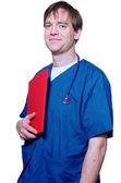 Handsome doctor holding folder — Stock Photo
