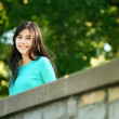 Young teen girl standing on bridge — Stock Photo