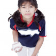Little girl in softball team uniform ready to throw a pitch — Stock Photo