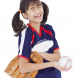 Girl laughing while holding softball and mitt, isolated — Stock Photo