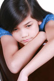 Sad nine year old girl — Stock Photo