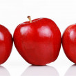 Three shiny red apples — Stock Photo