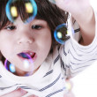 Stock Photo: Toddler boy playing with bubbles