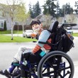 Stock Photo: Happy little disabled boy in wheelchair