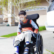 Happy little disabled boy in wheelchair — ストック写真