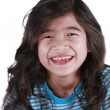 Happy seven year old girl smiling — Stok Fotoğraf #26392791