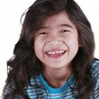 Happy seven year old girl smiling — Stock Photo