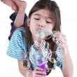 Stock Photo: Little girl blowing bubbles