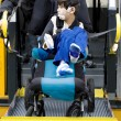 Stock Photo: Disabled boy on school bus wheelchair lift