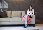 Young teen girl resting on an elegant couch — Stock Photo