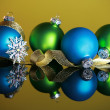 Christmas ornaments on yellow background — Stock Photo #2715392