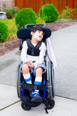Seven year old biracial disabled boy in wheelchair — Foto de Stock