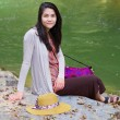 Biracial teen girl sitting by river in norhtern Thailand — Stock fotografie #38884887