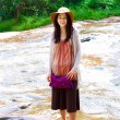 图库照片: Biracial teen girl standing in shallow water, smiling