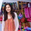 Teen girl shopping outdoor bazaar in Thailand — Stock Photo #38884917