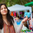 Stock Photo: Teen girl shopping outdoor bazaar in Thailand