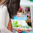 Teen girl shopping outdoor bazaar in Thailand — Stock Photo #38884925