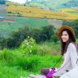Stock Photo: Teen girl sitting on hillside of Thailand