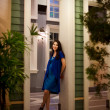 Stock Photo: Beautiful teen girl standing in doorway in evening