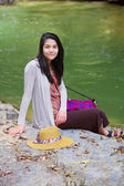Biracial teen girl sitting by a river in norhtern Thailand — Stock Photo