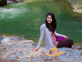 Biracial teen girl sitting by a river in norhtern Thailand — Stok fotoğraf
