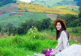 Teen girl sitting on hillside of Thailand — Stock Photo