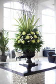 Beautiful flower arrangement in large foyer — Stock Photo