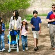 Family walking along country path — Stock Photo