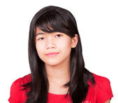 Preteen biracial girl in red shirt on white background — 图库照片