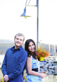 Interracial couple standing by boat pier — Stock Photo