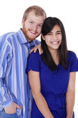 Happy young interracial couple in blue, early twenties or late t — Stock Photo