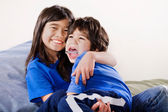 Big sister holding her disabled little brother — Stock Photo