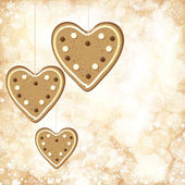 Christmas background with golden lights and gingerbread hearts. — Stock Vector