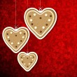 Christmas background with gingerbread hearts. — Stock Vector