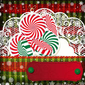 Christmas decorations on handmade knitted background. — Stock Vector