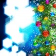 Christmas background with snow-covered Christmas tree decorated — Stockvectorbeeld