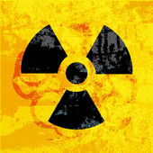 Radioactivity symbol on grungy background — Stock Vector