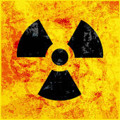 Radioactivity symbol on grungy background — Stock Vector